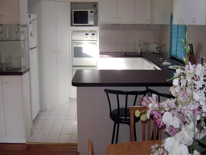 A kitchen or kitchenette at Accommodation Sydney North - Forestville 4 bedroom 2 bathroom house