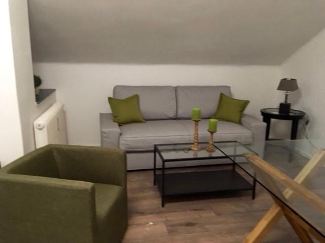 A seating area at Apartments an der Salzach