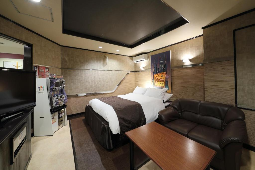 A bed or beds in a room at Hotel Fine Garden Okayama Ⅱ(Adult Only)