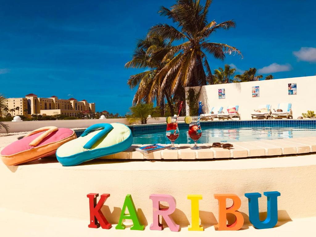 The swimming pool at or near Karibu Aruba Boutique Hotel