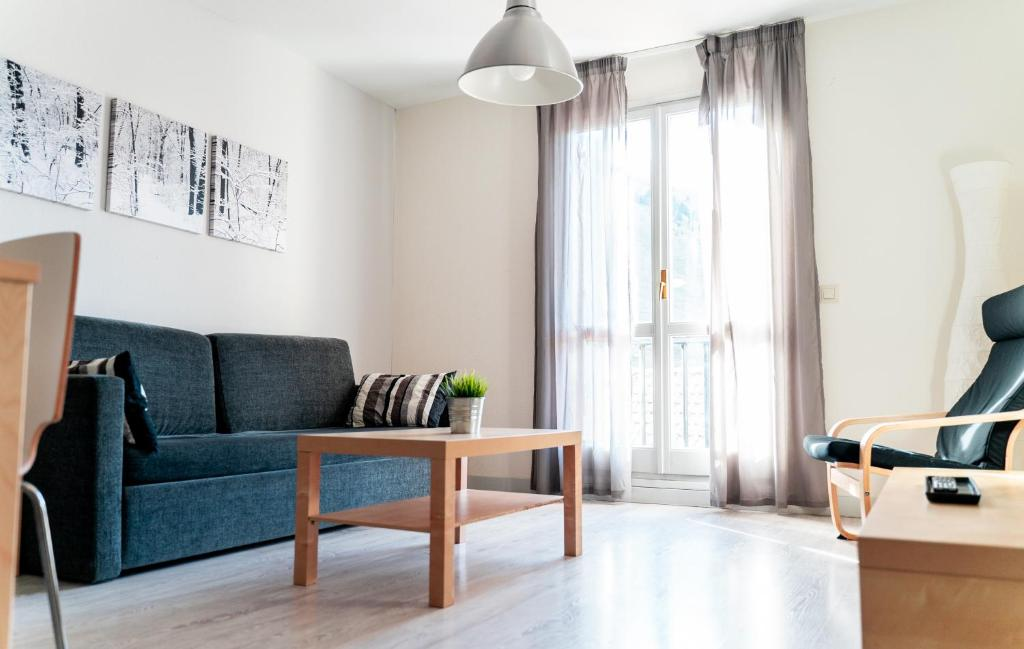 Zona de estar de Apartamentos Pirineos Rent