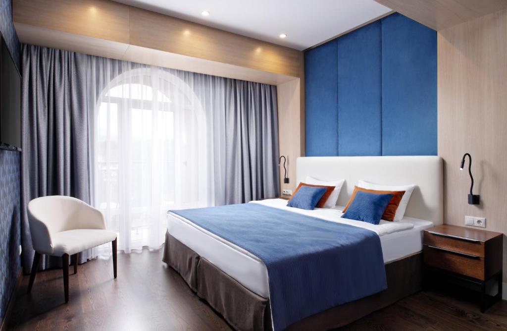 A bed or beds in a room at Health Resort Arnika