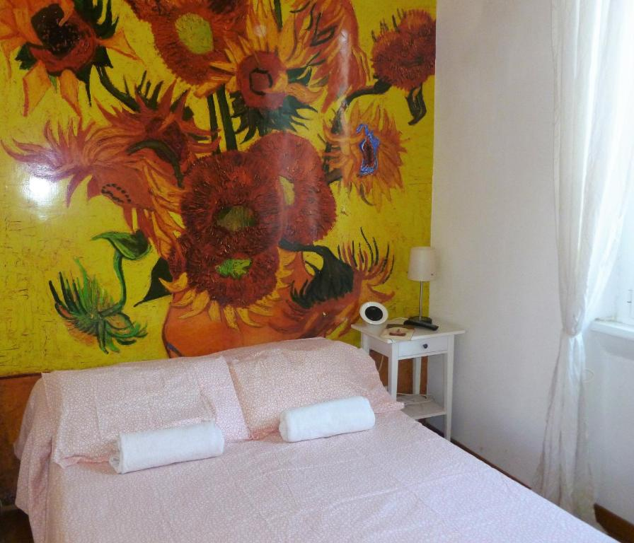 A bed or beds in a room at B&B Vincent Van Vogh