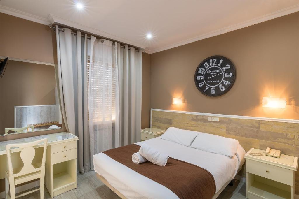 Een bed of bedden in een kamer bij Hotel Mexico