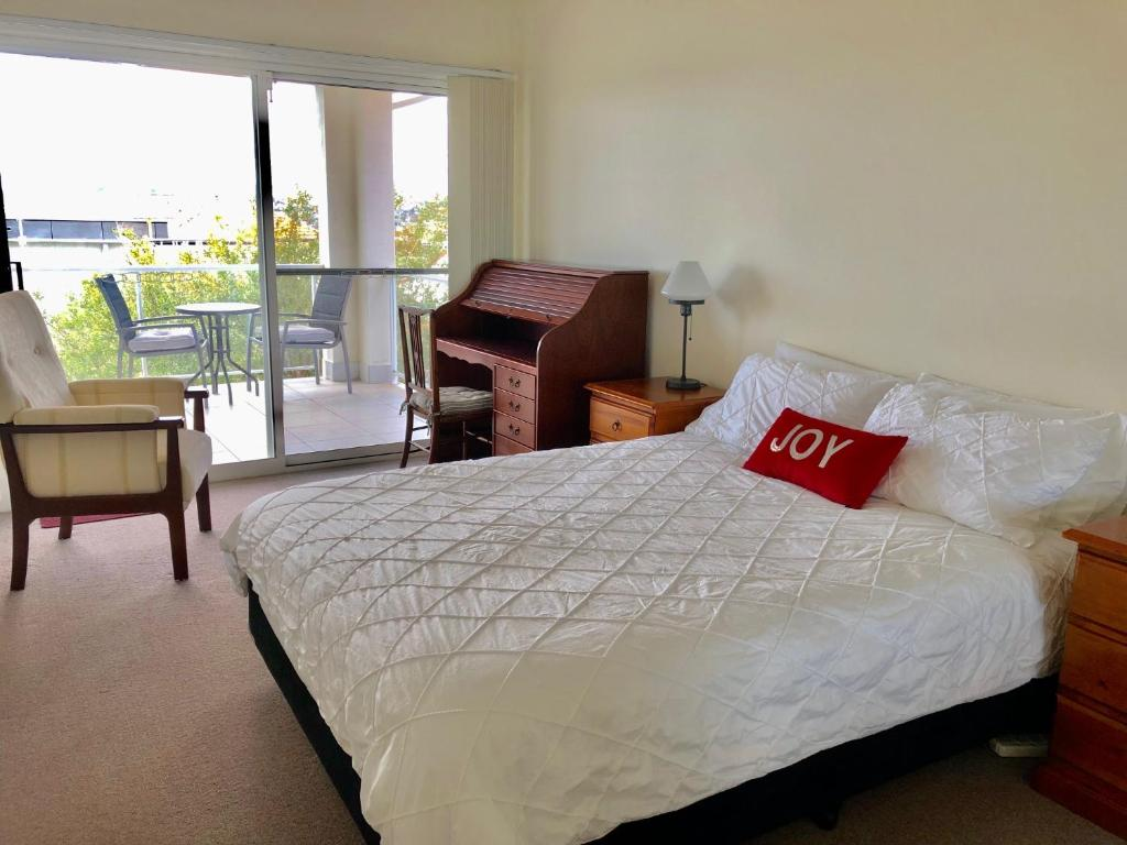 A bed or beds in a room at Welcome Home