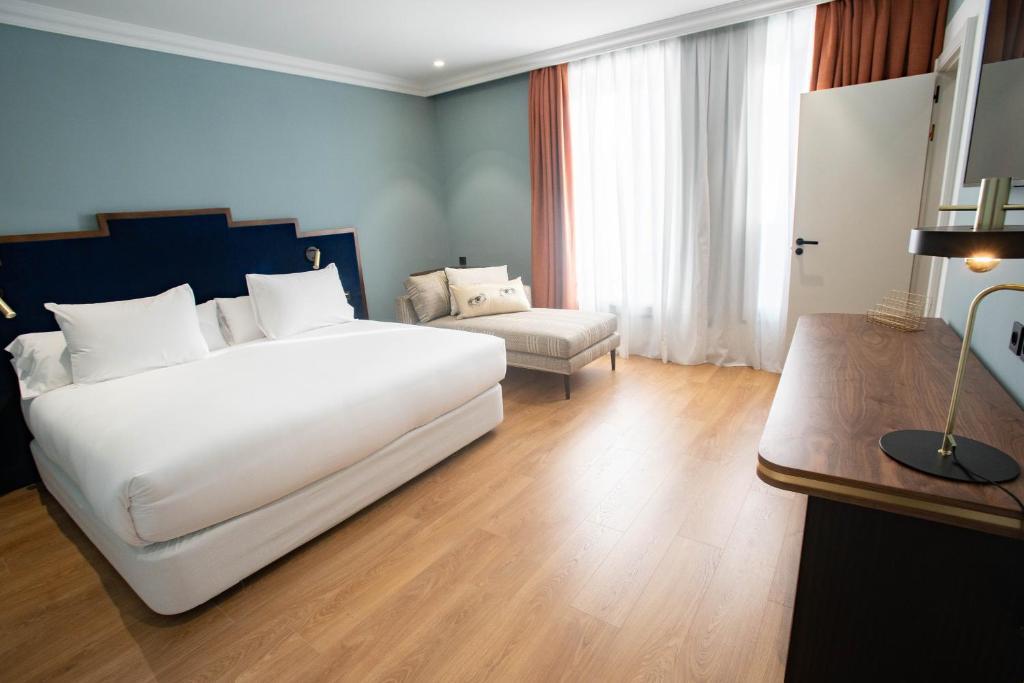 Llit o llits en una habitació de Soho Boutique Congreso