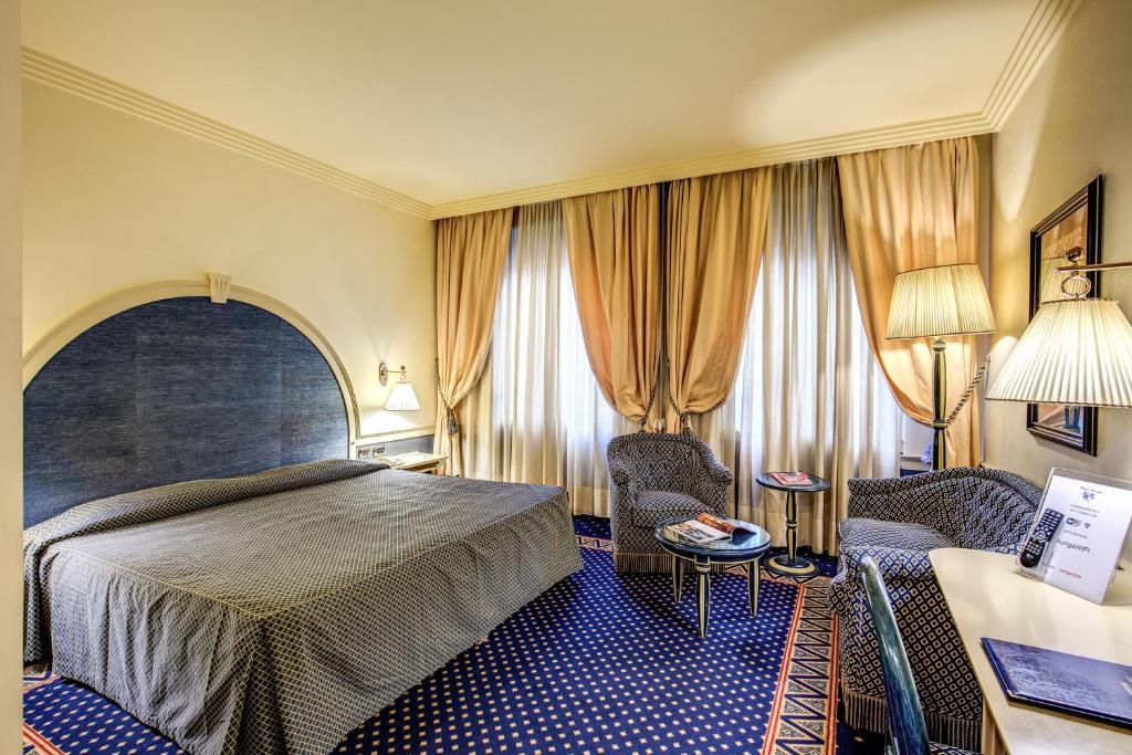 Cama ou camas em um quarto em Hotel Auriga