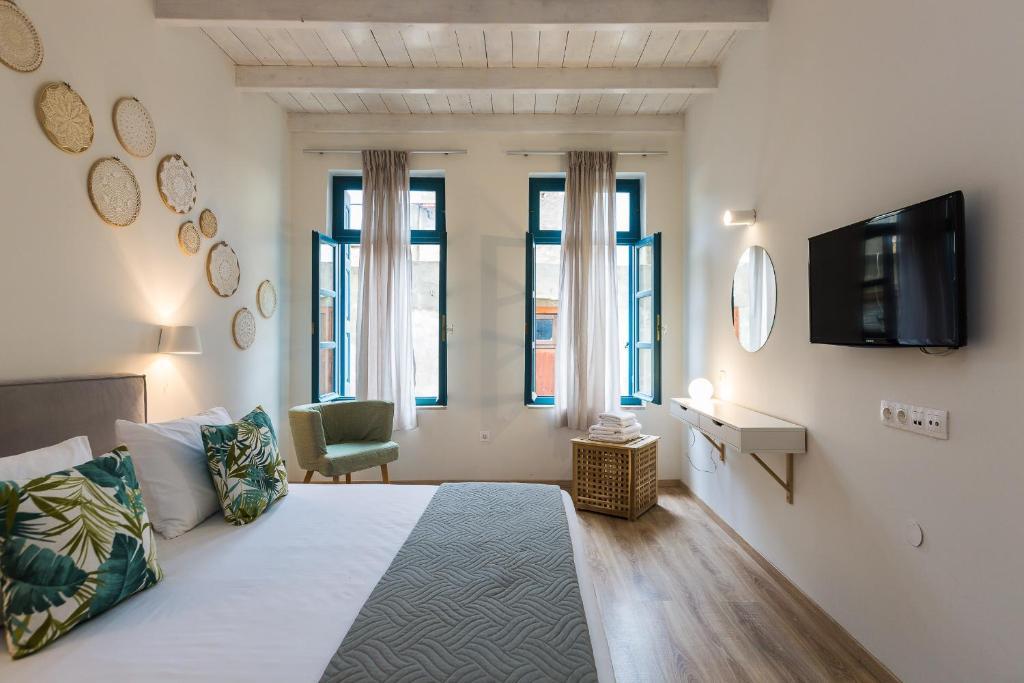 מיטה או מיטות בחדר ב-Daria's Ηome
