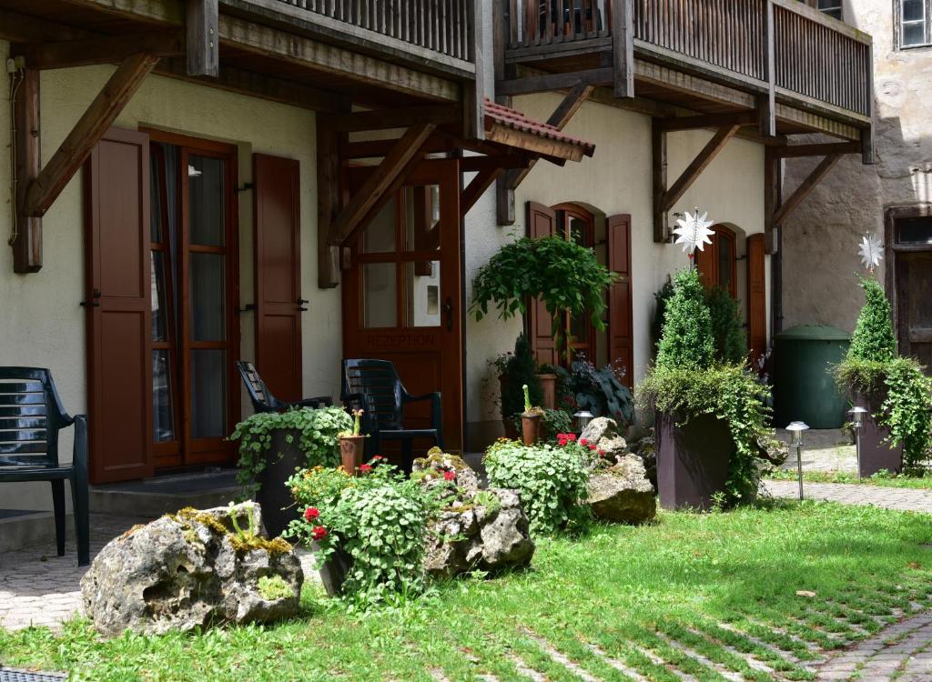 A garden outside Hotel Sonne