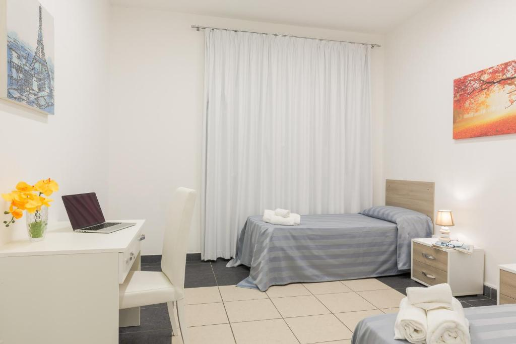 A bed or beds in a room at Casa per Ferie Don Orione Palermo