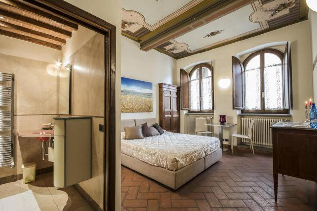 A bed or beds in a room at La Corte Del Re