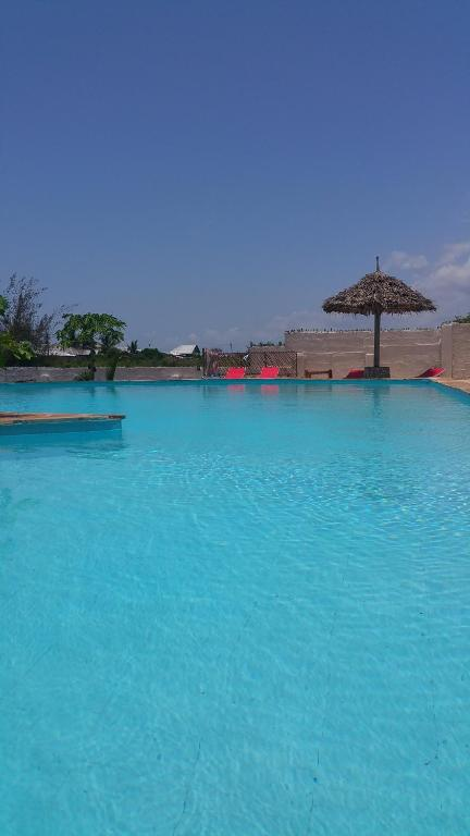 The swimming pool at or near Jua Apartments