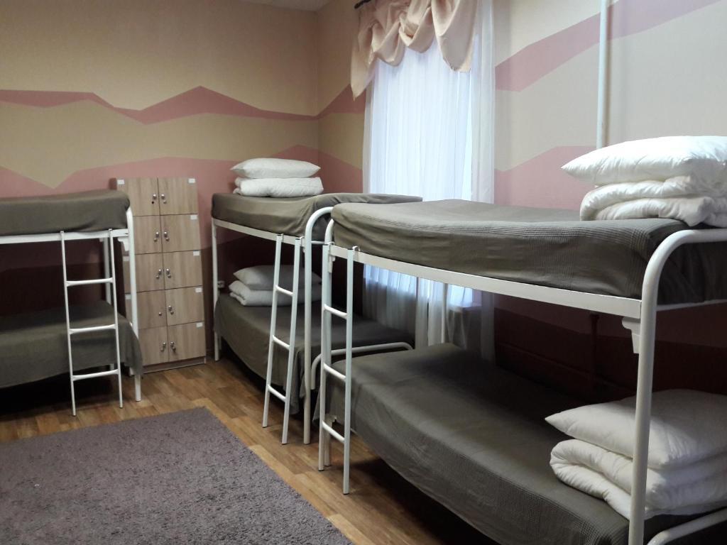 A bunk bed or bunk beds in a room at BM Hostel V. Novgorod