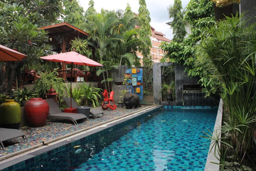 The swimming pool at or near Villa Thapae