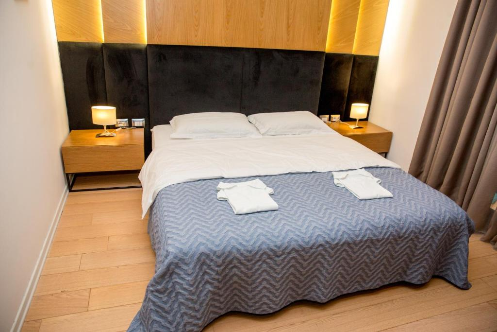 A bed or beds in a room at B Hotel Center