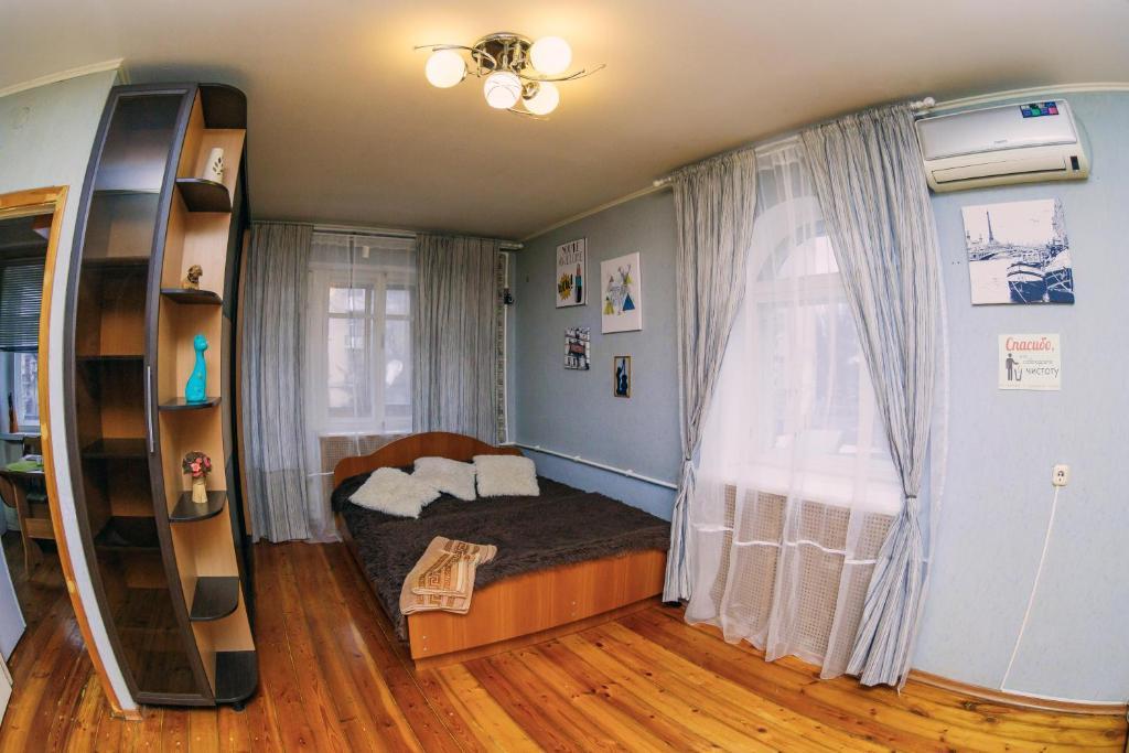 Кровать или кровати в номере Apartment on Prosveshcheniya 106