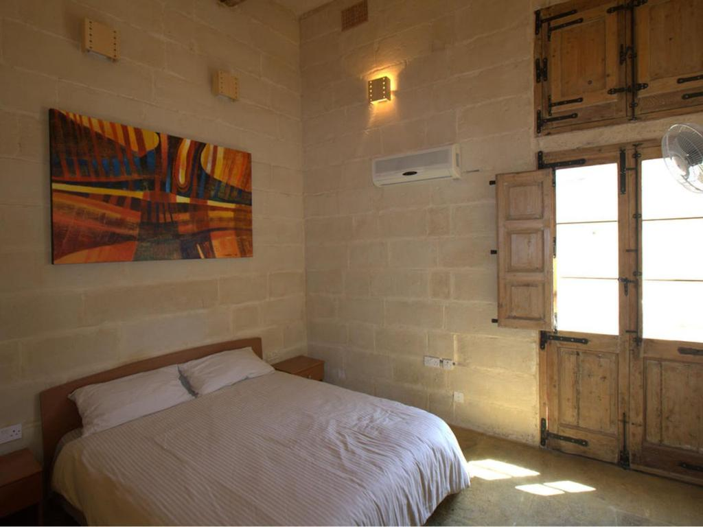A bed or beds in a room at Domus Luxuria - Qormi