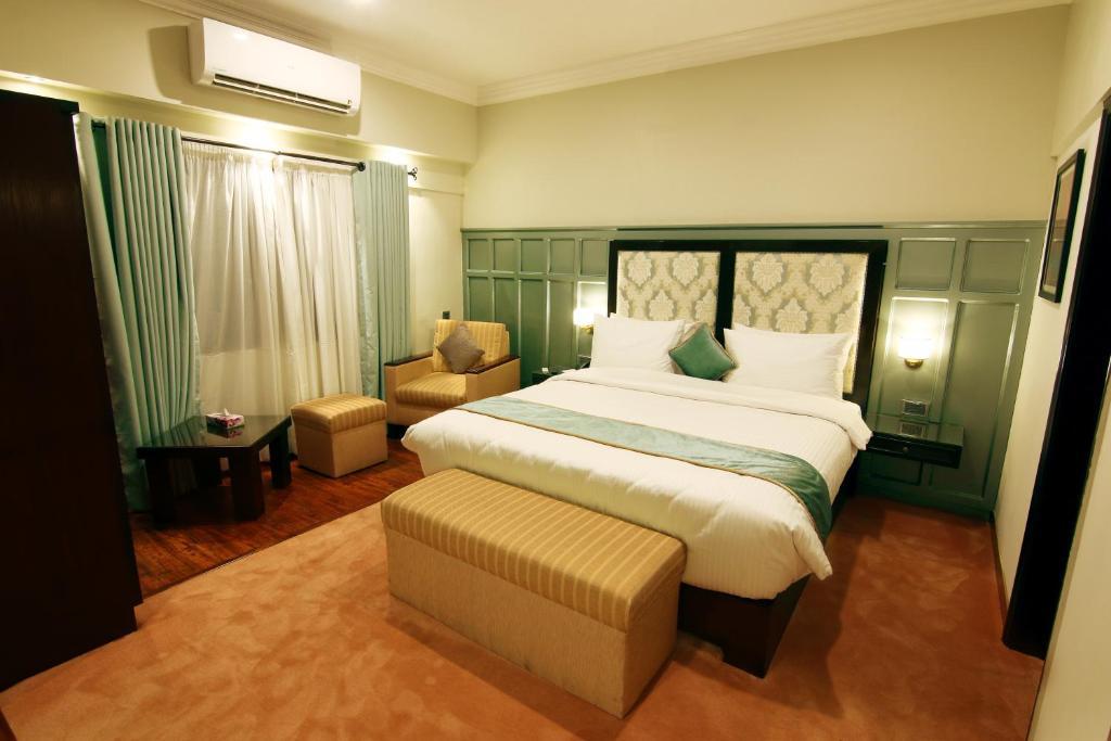 Ein Bett oder Betten in einem Zimmer der Unterkunft The Reserve