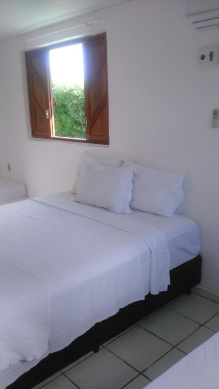 Cama ou camas em um quarto em Casa Tota Noronha