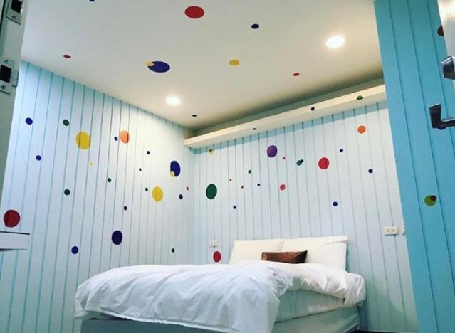 Katil atau katil-katil dalam bilik di Peacock hotel