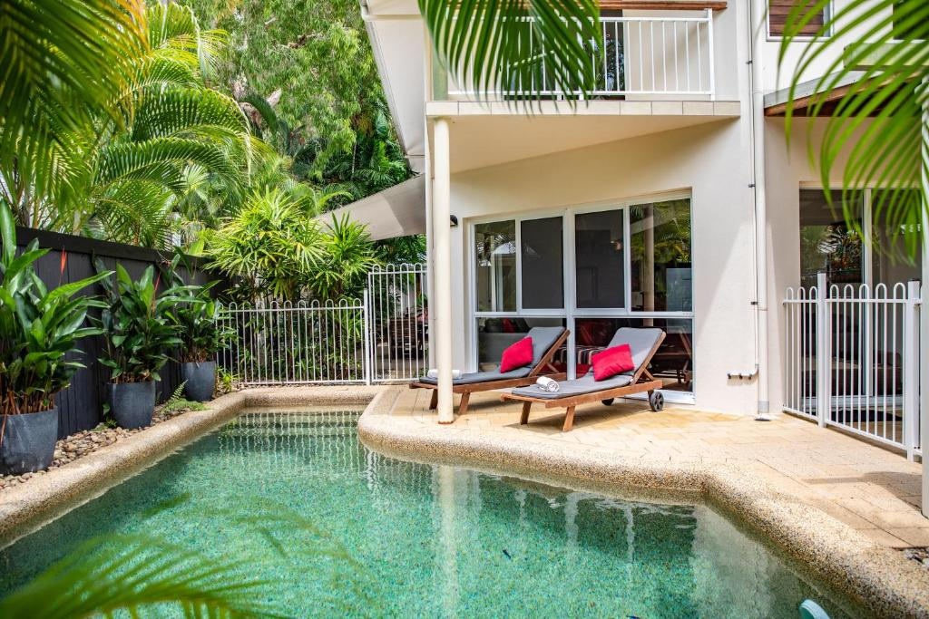 The swimming pool at or near Four Mile Beach Retreat