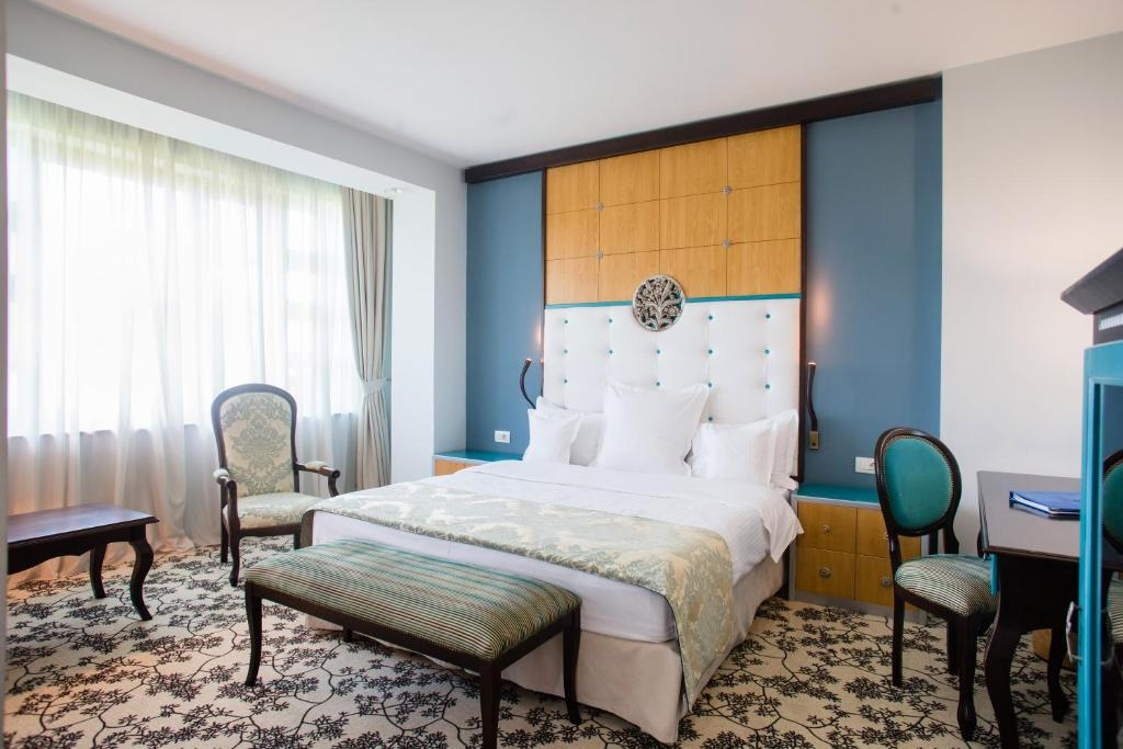 A bed or beds in a room at Pleiada Boutique Hotel & Spa