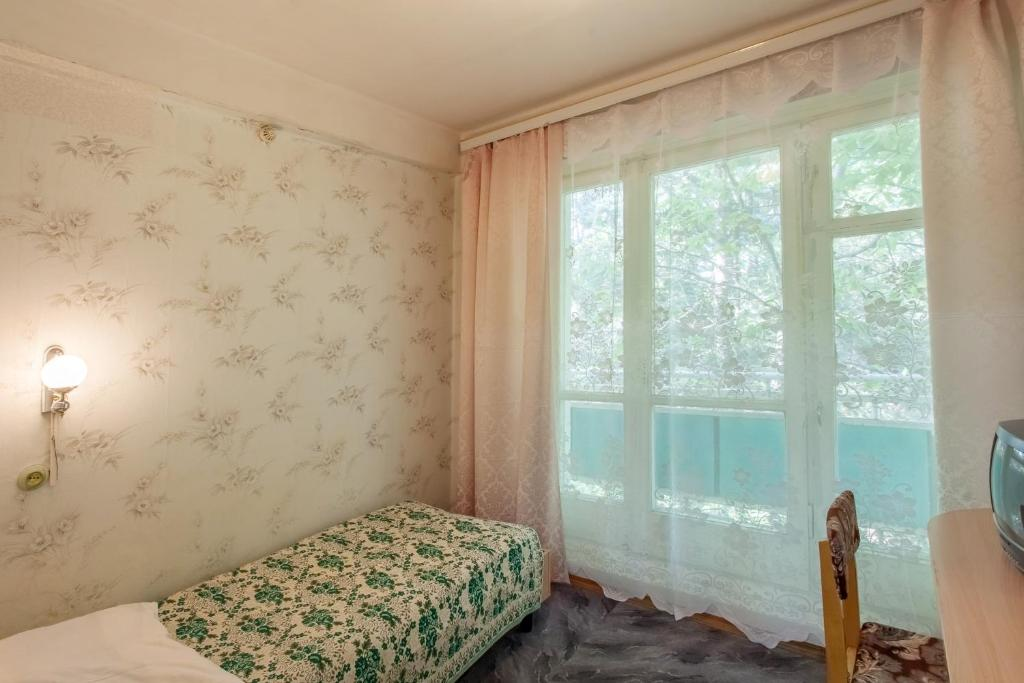 A bed or beds in a room at Lermontov Health Resort