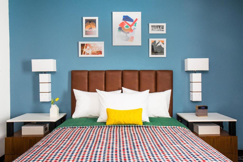 A bed or beds in a room at Uptown Suites Extended Stay Denver CO -Westminster