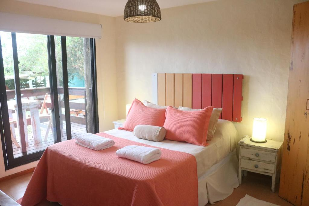 A bed or beds in a room at Posada de la Viuda