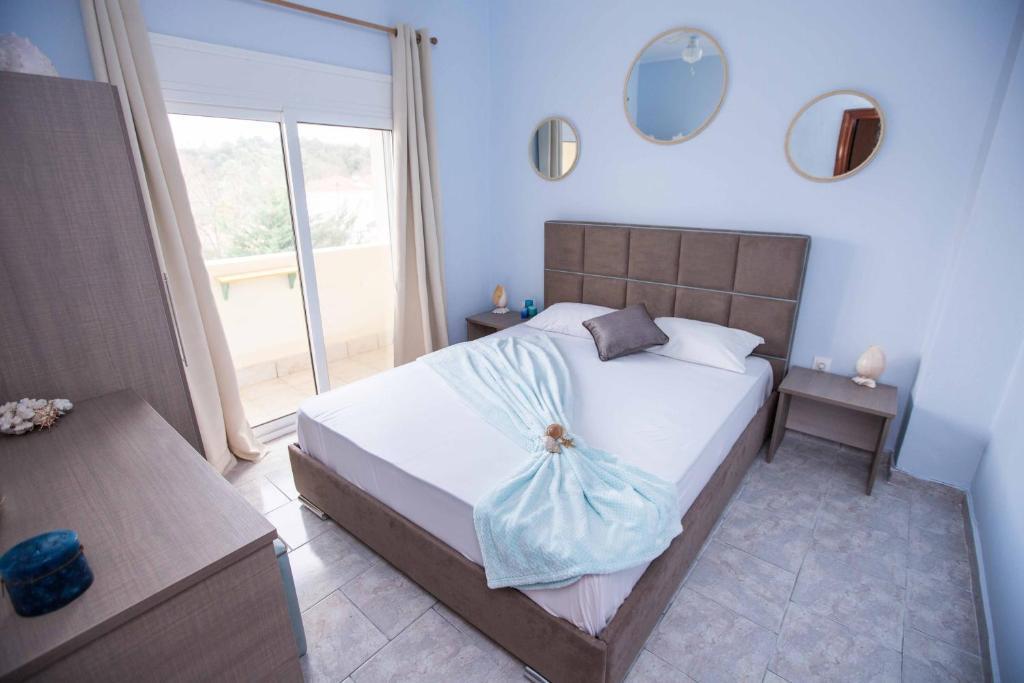 Een bed of bedden in een kamer bij Villa Pavlina