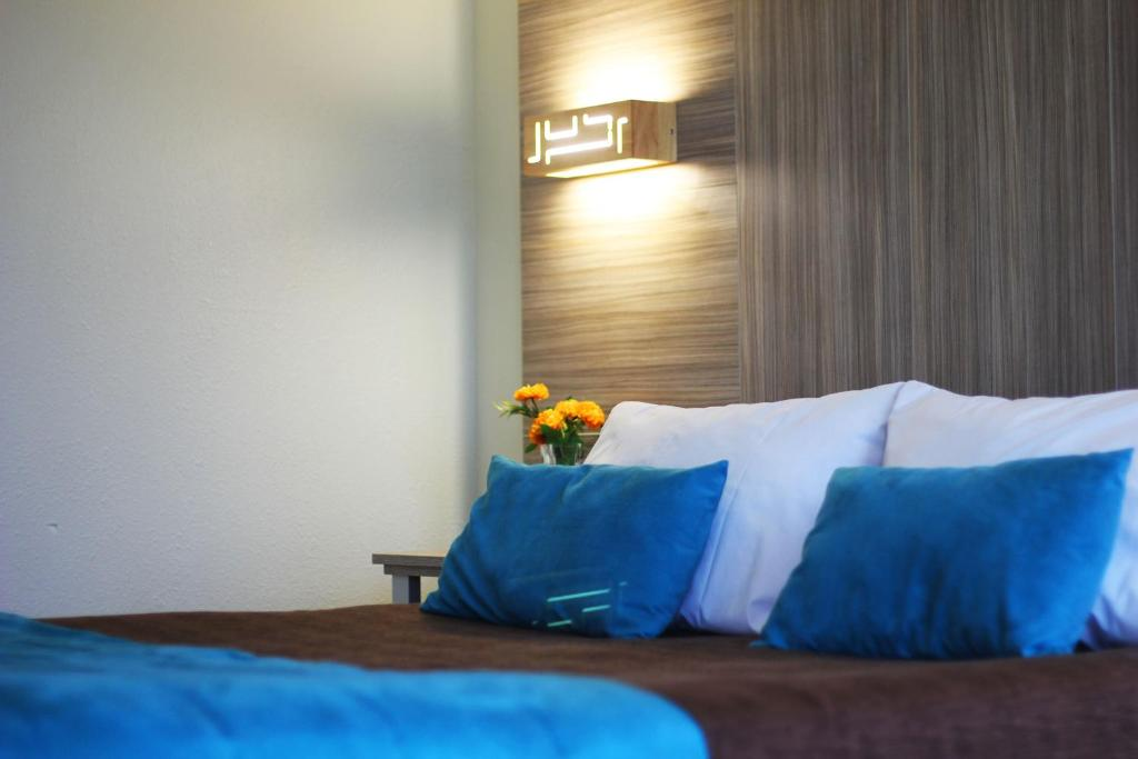 Cama o camas de una habitación en Hotel D&V Concepción