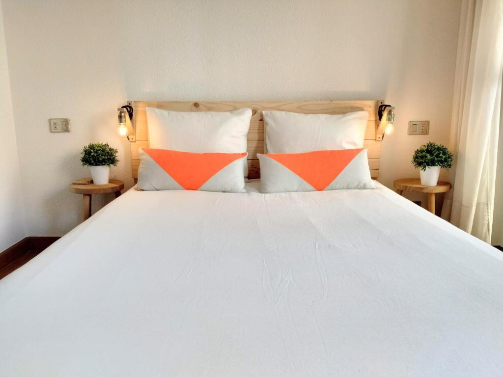 A bed or beds in a room at Mïlú Guesthouse
