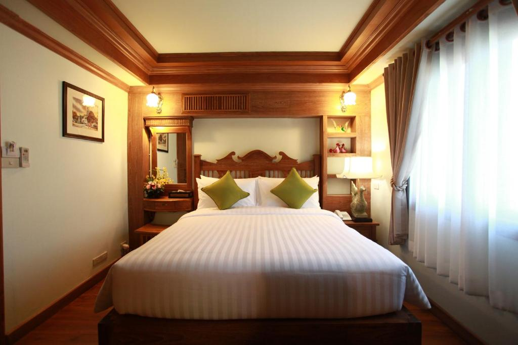 A bed or beds in a room at Rich Lanna House