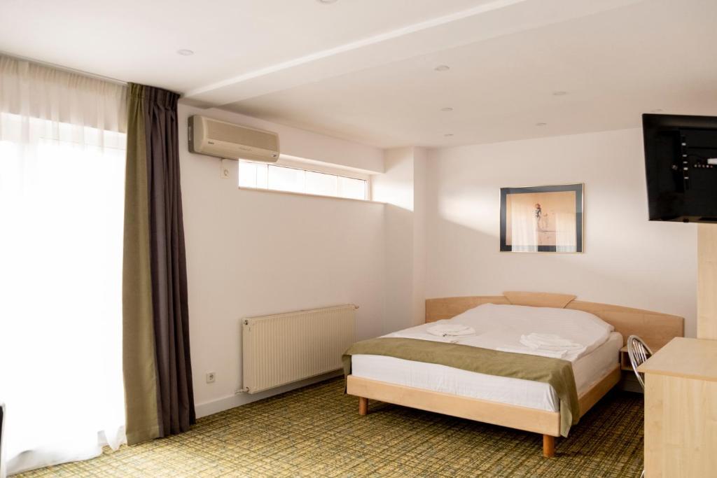 Uma cama ou camas num quarto em Casa Gabriela