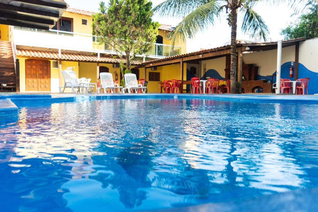 The swimming pool at or near Pé N'Areia