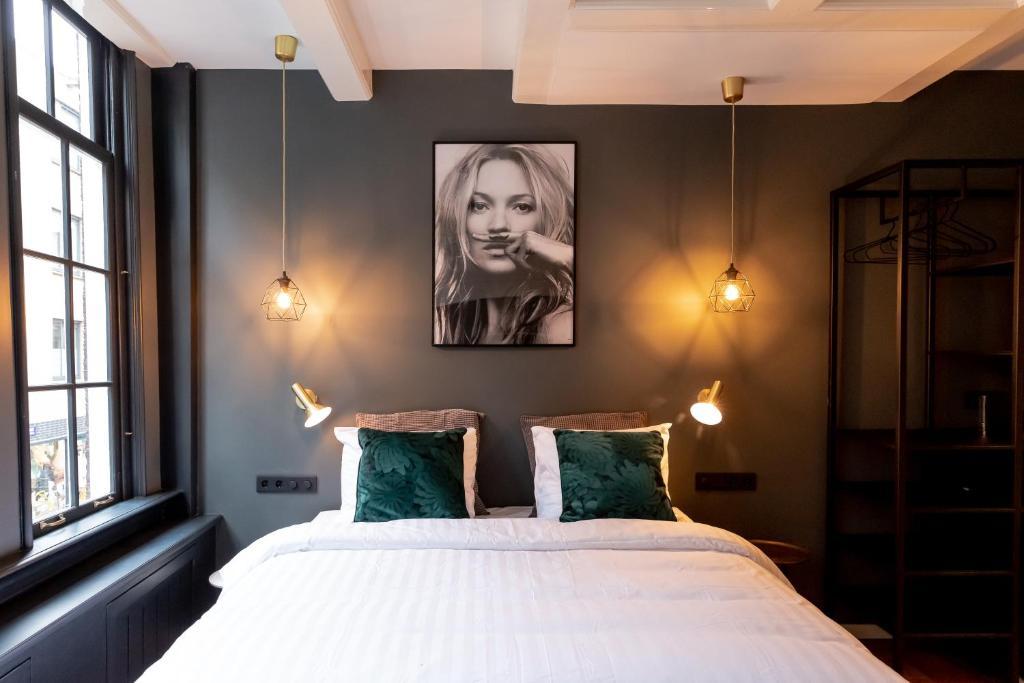 Un ou plusieurs lits dans un hébergement de l'établissement The Blossom House Amsterdam