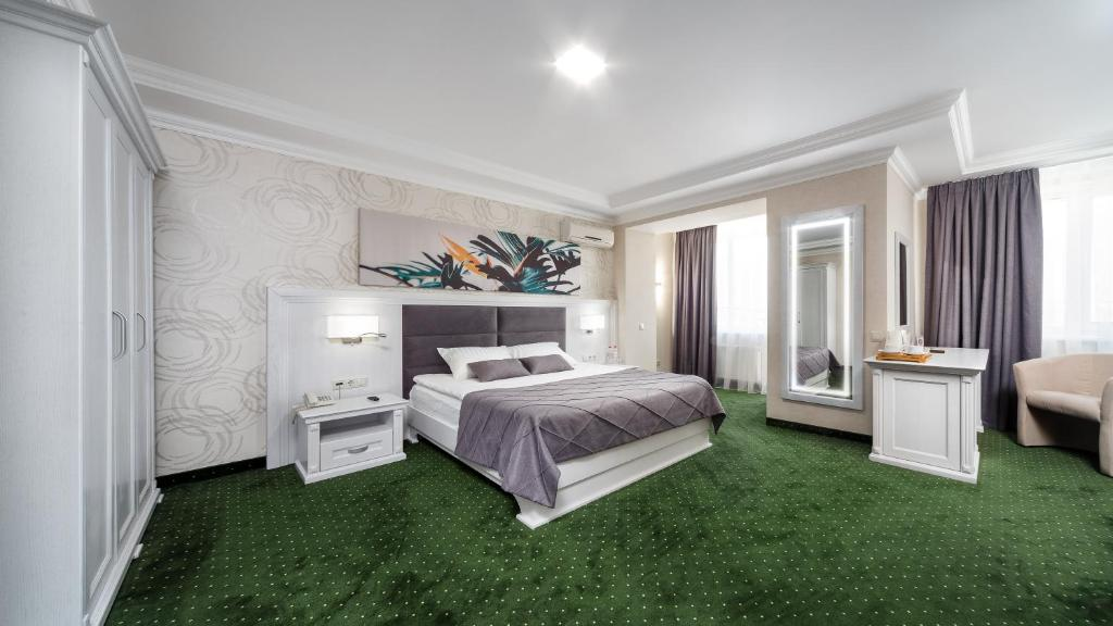 A bed or beds in a room at Sonata