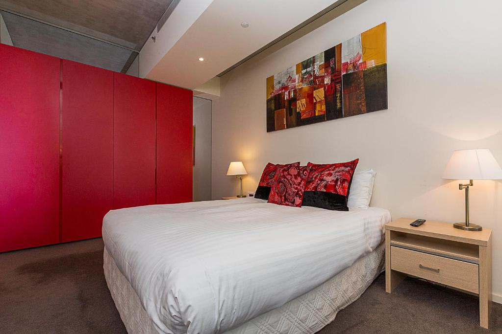 A bed or beds in a room at Accommodate Canberra - New Acton