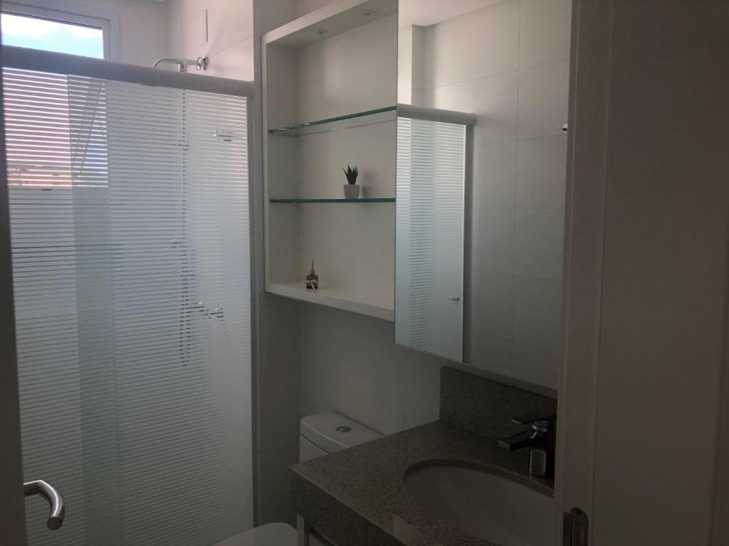 Un baño de Apartamento Super Aconchegante