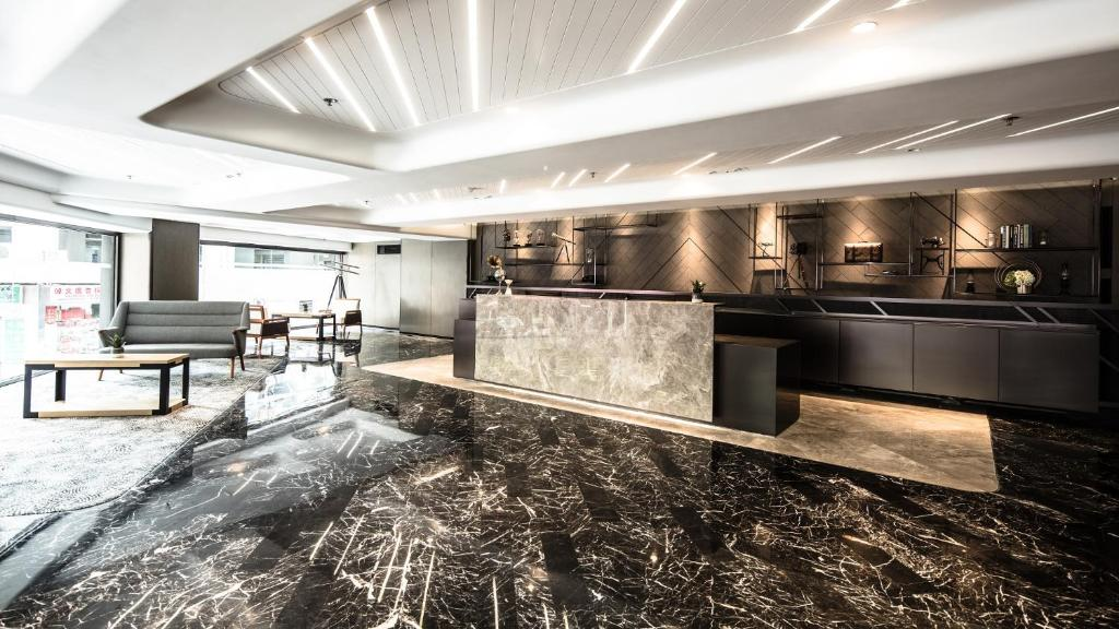 The lobby or reception area at Hotel Ease Tsuen Wan