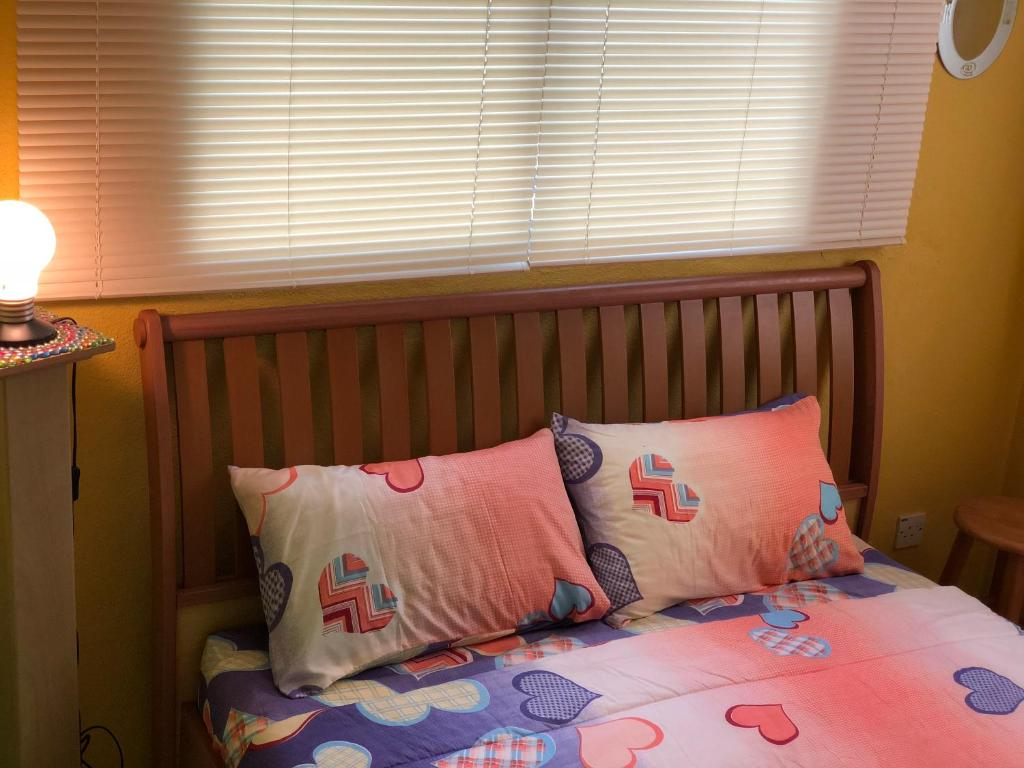 A bed or beds in a room at Glory's Cozy home stay