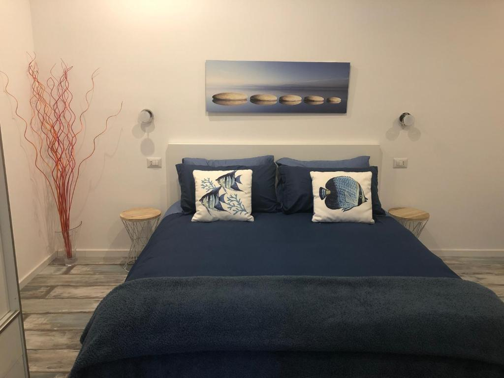 A bed or beds in a room at Il Ciottolo Sorrento