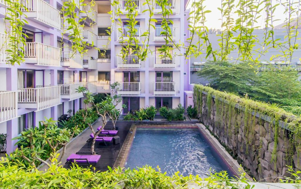 The swimming pool at or near Instyle Hotel Kuta