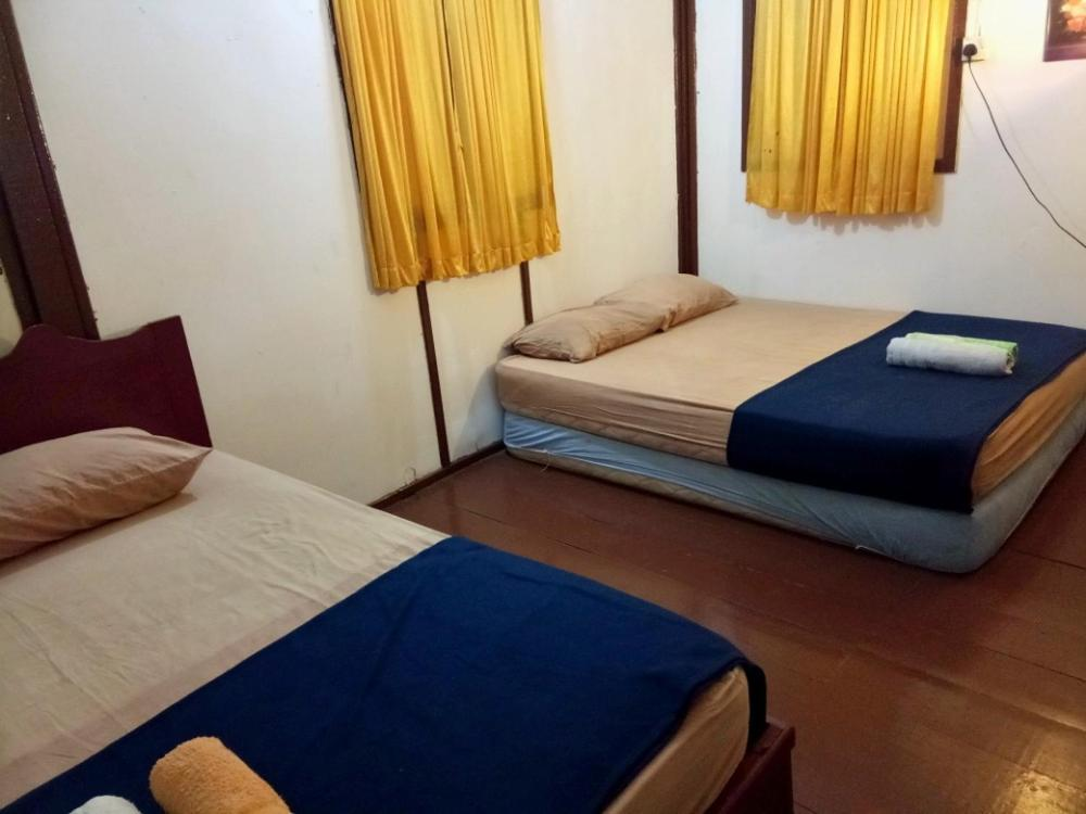 A bed or beds in a room at Marina Bay Resort & Restaurant