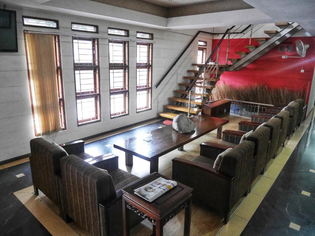 A seating area at Rumah Tawa Hotel Syariah