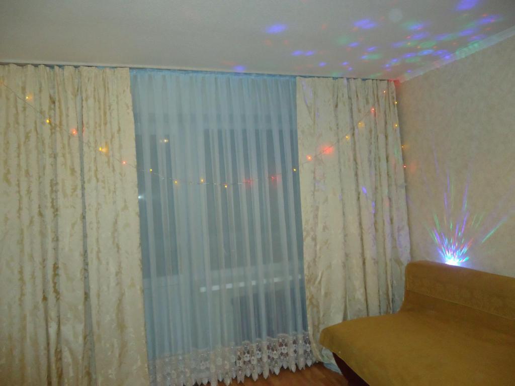 Кровать или кровати в номере Микрорайон Александровский