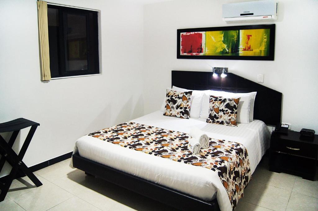 Cama o camas de una habitación en Hotel Cafeira
