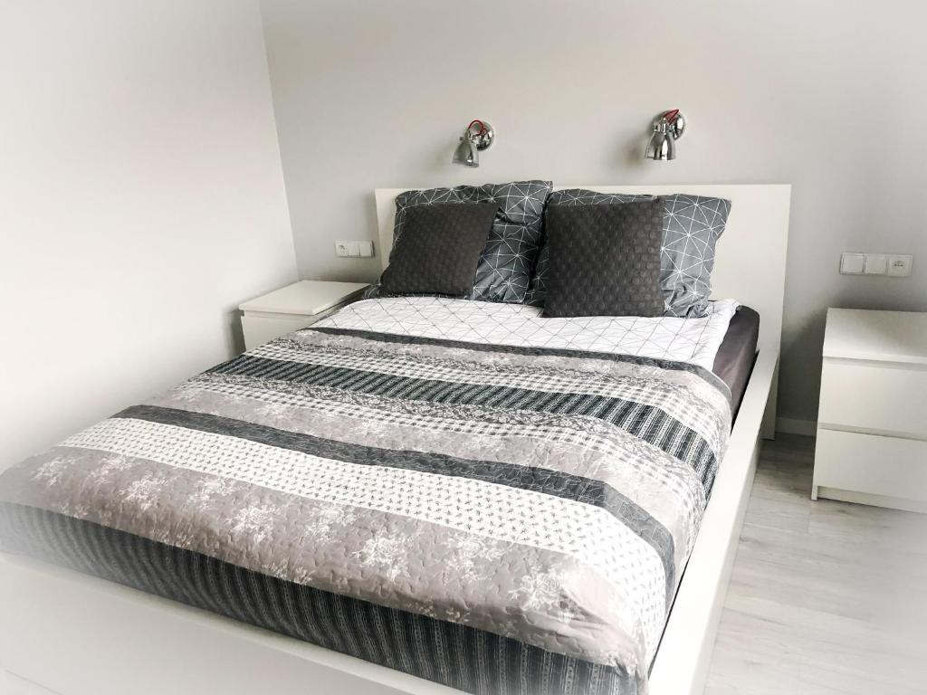 A bed or beds in a room at Lux Apartment