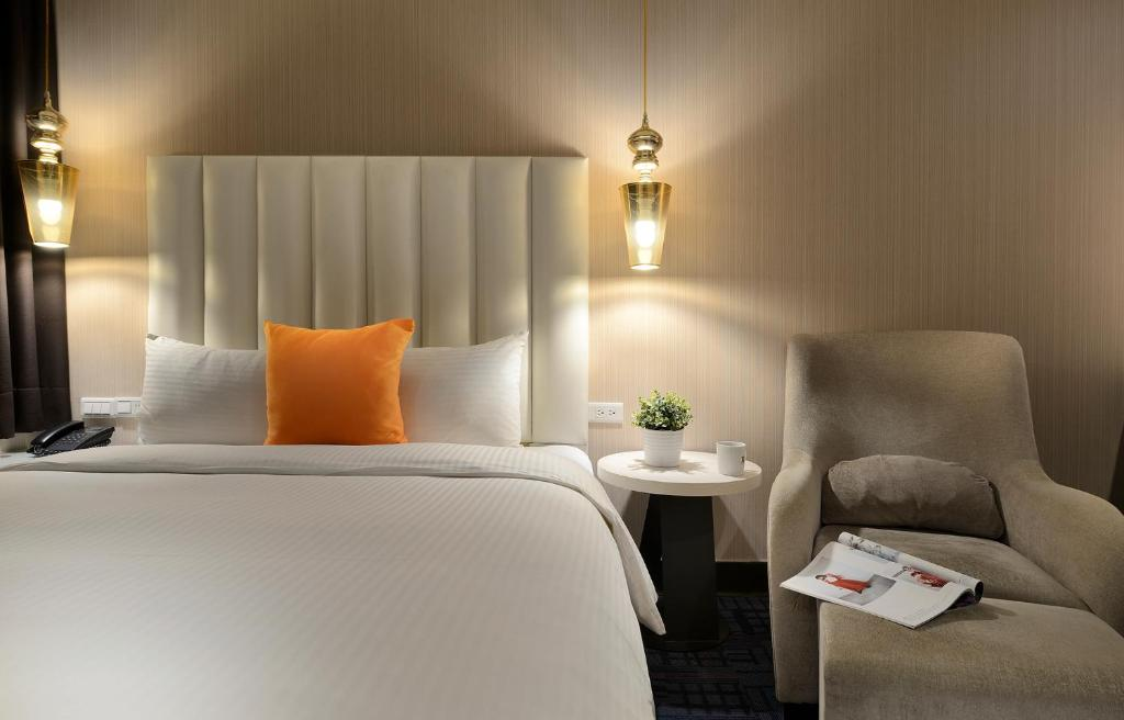 A bed or beds in a room at Via Hotel
