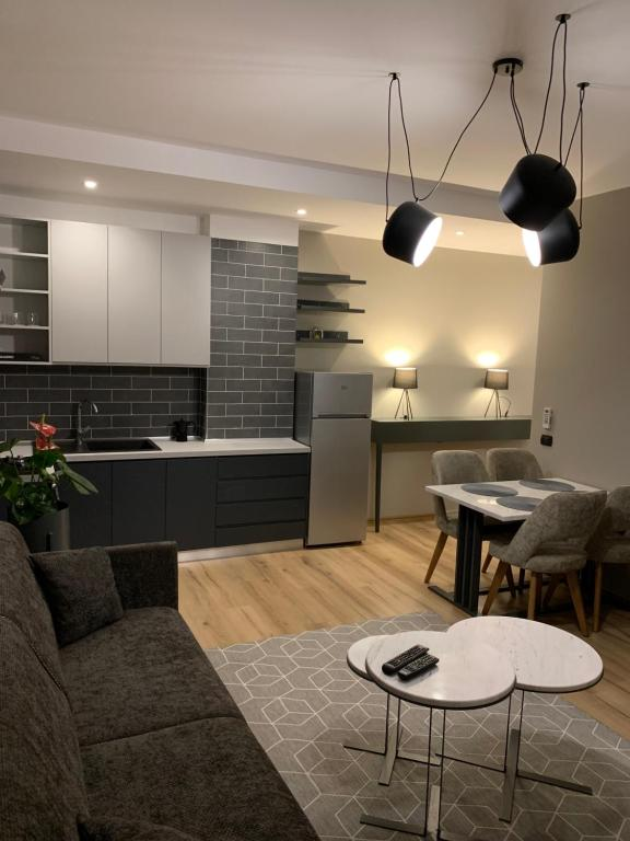 A kitchen or kitchenette at Tirana LUX Apartments